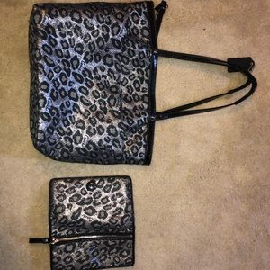 Coach tote bag and matching Coach wristlet wallet.